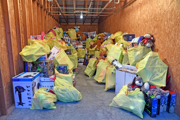 """Charles Williams and family with semi-truck sized donation of toys to """"Chucky's Mission"""""""